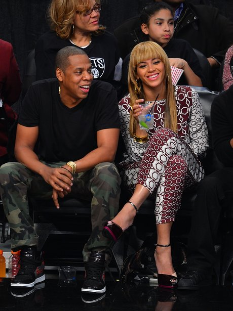 Jay-Z and Beyonce Knowle watch basketball
